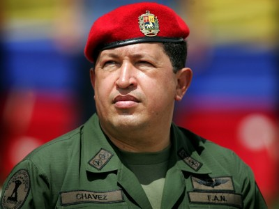 Venezuela's President Hugo Chavez wears an army uniform and the red beret of his parachute regiment while attending a military parade in Caracas in this April 13, 2005 file photo.  Chavez has died after a two-year battle with cancer, ending the socialist leader's 14-year rule of the South American country, Vice President Nicolas Maduro said in a televised speech on March 5, 2013. REUTERS/Jorge Silva/Files (VENEZUELA - Tags: POLITICS OBITUARY TPX IMAGES OF THE DAY)