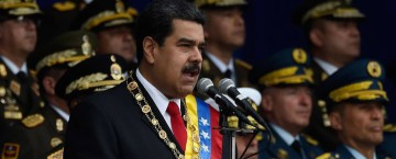 Venezuelan President Nicolas Maduro delivers a speech during a ceremony to celebrate the 81st anniversary of the National Guard in Caracas on August 4, 2018 day in which Venezuela's controversial Constituent Assembly marks its first anniversary. The Constituent Assembly marks its first anniversary on August 4 as the embodiment of Maduro's entrenchment in power despite an economic crisis that has crippled the country's public services and destroyed its currency. The assembly's very creation last year was largely responsible for four months of street protests that left some 125 people dead.  / AFP PHOTO / Juan BARRETO